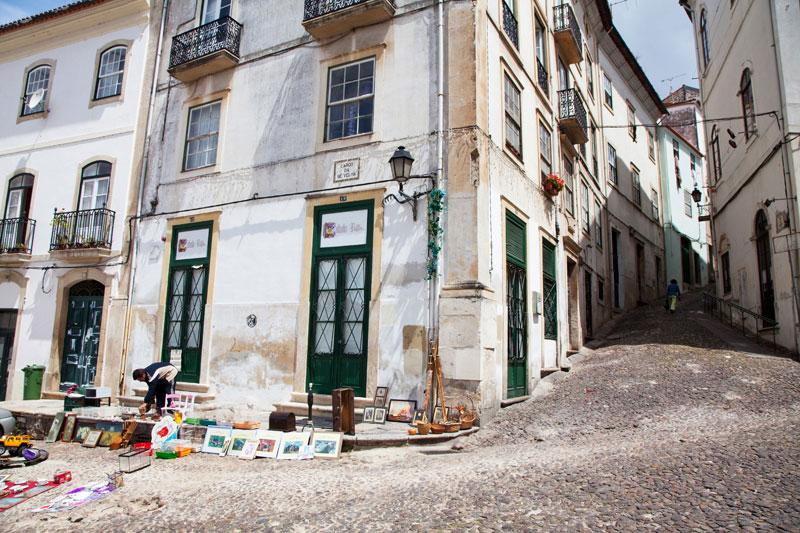 Narrow streets lead upwards in Coimbra, Portugal
