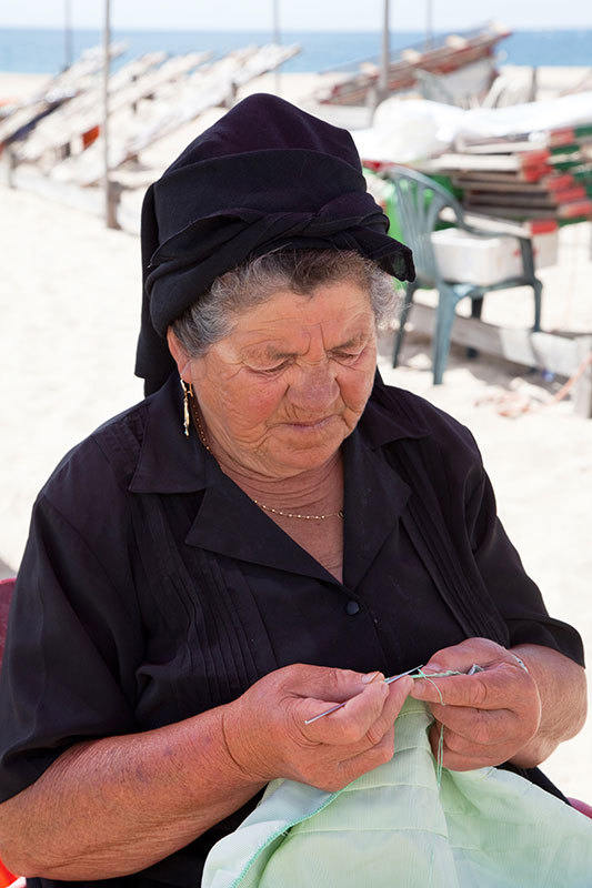 Woman on the beach of Nazare, Portugal