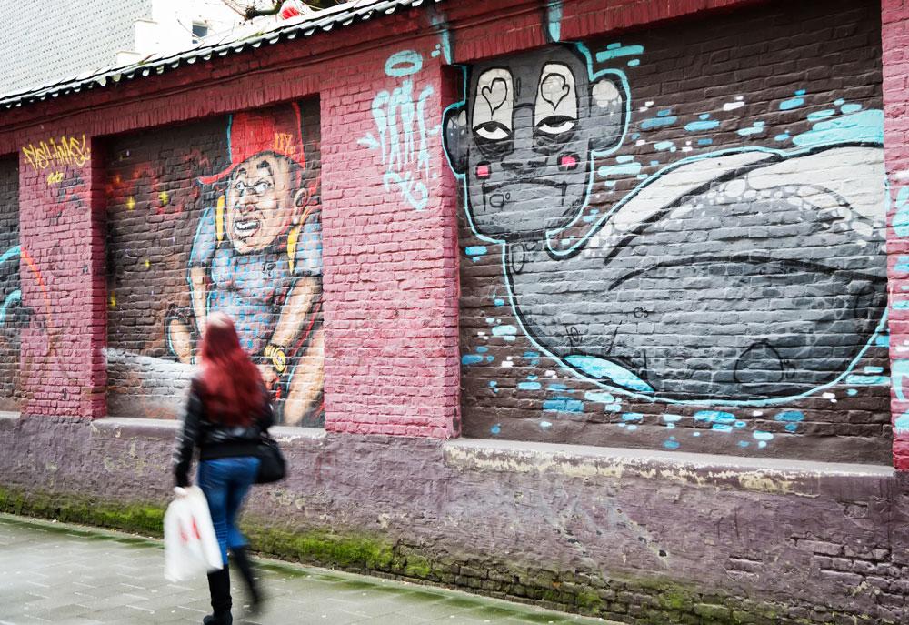 Stedentrip Gent, Belgie: de Concrete Canvas Tour langs de mooiste street art zoals in de Tweebruggenstraat.